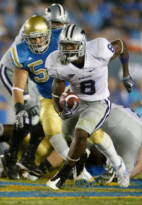 PASADENA, CA - SEPTEMBER 19:  Daniel Thomas #8 of the Kansas State Wildcats is pursued by Jess Ward #52 of the UCLA Bruins in the third quarter at the Rose Bowl on September 19, 2009 in Pasadena, California. UCLA defeated Kansas State 23-9.  (Photo by Jef