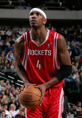 DALLAS - NOVEMBER 22:  Stromile Swift #4 of the Houston Rockets shoots a free throw during the game against the Dallas Mavericks at the American Airlines Center on November 22, 2005 in Dallas, Texas.  The Mavericks won 102-93.  NOTE TO USER: User expressl