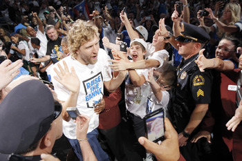 DALLAS, TX - JUNE 16: Forward Dirk Nowitzki of the Dallas Mavericks high fives fans during the Dallas Mavericks Victory celebration on June 16, 2011 in Dallas, Texas. (Photo by Brandon Wade/Getty Images)