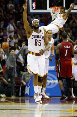 CLEVELAND - MARCH 29: Baron Davis #85 of the Cleveland Cavaliers celebrates after his team scored against the Miami Heat during the game against the Cleveland Cavaliers on March 29, 2011 at Quicken Loans Arena in Cleveland, Ohio. NOTE TO USER: User expres