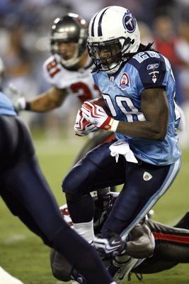 NASHVILLE, TN - AUGUST 15: Chris Johnson #28 of the Tennessee Titans runs with the ball against the Tampa Bay Buccaneers during a preseason NFL game at LP Field on August 15, 2009 in Nashville, Tennessee. The Titans beat the Buccaneers 27-20. (Photo by Jo