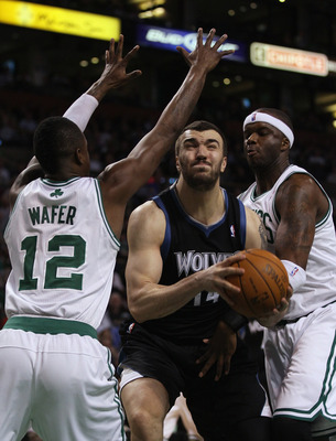 BOSTON, MA - JANUARY 03:  Nikola Pekovic #14 of the Minnesota Timberwolves tries to get between Von Wafer #12 and Jermaine O'Neal #7 of the Boston Celtics on January 3, 2011 at the TD Garden in Boston, Massachusetts. The Celtics defeated the Timberwolves