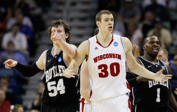 NEW ORLEANS, LA - MARCH 24:  Jon Leuer #30 of the Wisconsin Badgers. Matt Howard #54 and Shelvin Mack #1 of the Butler Bulldogs react during the Southeast regional of the 2011 NCAA men's basketball tournament at New Orleans Arena on March 24, 2011 in New