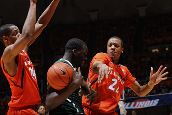 CHAMPAIGN, IL - JANUARY 18: Jereme Richmond #22 and Mike Davis #24 of the Illinois Fighting Illini apply pressure against Draymond Green #23 of the Michigan State Spartans in the first half at Assembly Hall on January 18, 2011 in Champaign, Illinois. (Pho