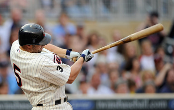 MINNEAPOLIS, MN - JUNE 17: Michael Cuddyer #5 of the Minnesota Twins gets an RBI double against the San Diego Padres in the first inning on June 17, 2011 at Target Field in Minneapolis, Minnesota. (Photo by Hannah Foslien/Getty Images)