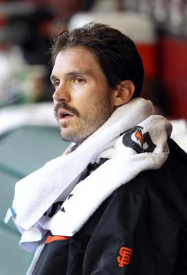 PHOENIX, AZ - APRIL 16:  Starting pitcher Barry Zito #75 of the San Francisco Giants sits in the dugout before the Major League Baseball game against the Arizona Diamondbacks at Chase Field on April 16, 2011 in Phoenix, Arizona.  (Photo by Christian Peter