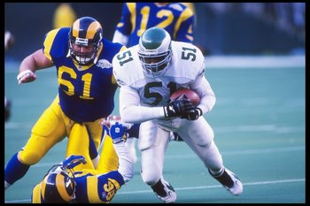 29 Oct 1995: Linebacker William Thomas of the Philadelphia Eagles tries to break away from guard Bern Brostek and tight end Jessie Hester of the St. Louis Rams during a game at Veterans Stadium in Philadelphia, Pennsylvania. The Eagles won the game 20-9.