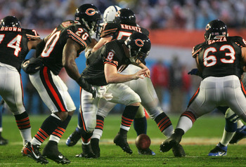 MIAMI GARDENS, FL - FEBRUARY 04:  Quarterback Rex Grossman #8 of the Chicago Bears fumbles a snap recoverd by the Indianapolis Colts during the second quarter of Super Bowl XLI on February 4, 2007 at Dolphin Stadium in Miami Gardens, Florida.  (Photo by J