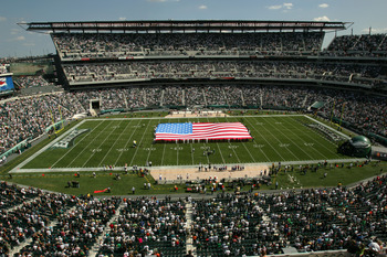 PHILADELPHIA - SEPTEMBER 18:  The American flag is brought onto the field during the singing of the National Anthem prior to the game between the Philadelphia Eagles and San Francisco 49ers on September 18, 2005 at Lincoln Financial Field in Philadelphia,
