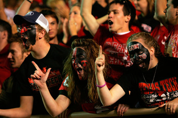 LUBBOCK, TX - NOVEMBER 17:  Fans of the Texas Tech Red Raiders reacts during play against the Oklahoma Sooners at Jones AT&T Stadium on November 17, 2007 in Lubbock, Texas.  (Photo by Ronald Martinez/Getty Images)