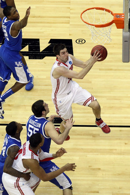 NEWARK, NJ - MARCH 25:  Jon Diebler #33 of the Ohio State Buckeyes goes to the basket against Josh Harrellson #55 of the Kentucky Wildcats during the first half of the east regional semifinal of the 2011 NCAA Men's Basketball Tournament at the Prudential