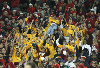 TUCSON, AZ - DECEMBER 02:  Fans of the Arizona State Sun Devils cheer during the college football game against the Arizona Wildcats at Arizona Stadium on December 2, 2010 in Tucson, Arizona.  The Sun Devils defeated the Wildcats 30-29 in double overtime.