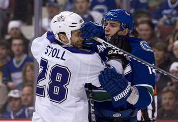 VANCOUVER, CANADA - MARCH 31: Alexandre Burrows #14 of the Vancouver Canucks and Jarret Stoll #28 of the Los Angeles Kings push and shove after the whistle during the second period in NHL action on March 31, 2011 at Rogers Arena in Vancouver, BC, Canada.