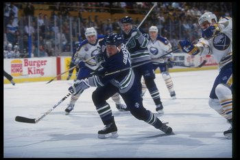 3 Feb 1993: Center Geoff Sanderson of the Hartford Whalers (center) moves down the ice during a game against the Buffalo Sabres at Memorial Auditorium in Buffalo, New York.