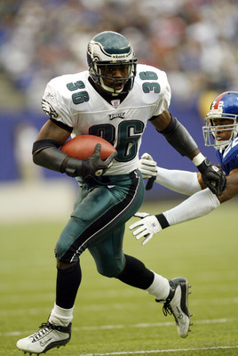 EAST RUTHERFORD, NJ - OCTOBER 19:  Brian Westbrook #36 of the Philadelphia Eagles rushes for a touchdown against the New York Giants at Giants Stadium on October 19, 2003 in East Rutherford, New Jersey. The Eagles defeated the Giants 14-10.  (Photo by Chr