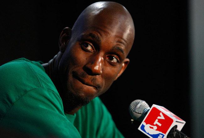 BOSTON - MAY 18:  Kevin Garnett #5 of the Boston Celtics looks towards teammate Paul Pierce #34 during their post game press conference after their 97-92 win against the Cleveland Cavaliers in Game Seven of the Eastern Conference Semifinals during the 200