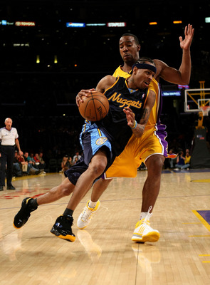 LOS ANGELES - JANUARY 21:  Allen Iverson #3 of the Denver Nuggets drives past Javaris Crittenton #1 of he Los Angeles Lakers on January 21, 2008 at Staples Center in Los Angeles, California. NOTE TO USER: User expressly acknowledges and agrees that, by do