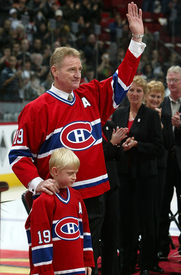 MONTREAL - NOVEMBER 19:  Former Montreal Canadien Larry Robinson #19 stands with his grandson Dylan durring a pre-game ceremony where the Montreal Canadiens retired his #19 prior to the Montreal Canadiens playing the Ottawa Senators during their NHL game