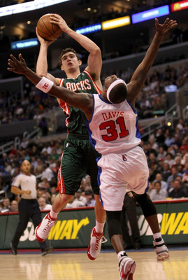 LOS ANGELES, CA - JANUARY 17:  Joe Alexander #11 of the Milwaukee Bucks scores a basket and picks up a foul from Ricky Davis #31 of the Los Angeles Clippers on January 17, 2009 at Staples Center in Los Angeles, California.   NOTE TO USER: User expressly a