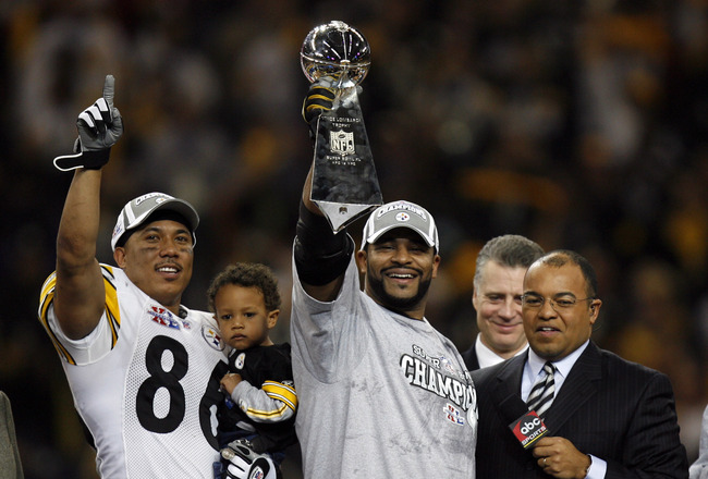 Hines Ward and Jerome Bettis celebrate with the Vince Lombardi Trophy after winning Super Bowl XL between the Pittsburgh Steelers and Seattle Seahawks at Ford Field in Detroit, Michigan on February 5, 2006. (Photo by Allen Kee/Getty Images)