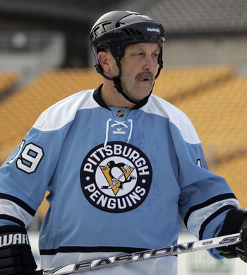 PITTSBURGH, PA - DECEMBER 31:  Bryan Trottier #19 of the Pittsburgh Penguins skates against the Washington Capitals during the 2011 NHL Winter Classic Alumni Game on December 31, 2010 at Heinz Field in Pittsburgh, Pennsylvania.  (Photo by Justin K. Aller/