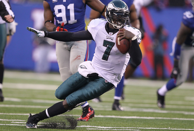 EAST RUTHERFORD, NJ - DECEMBER 19:  Michael Vick #7 of the Philadelphia Eagles scrambles for a big gain against the New York Giants during their game on December 19, 2010 at The New Meadowlands Stadium in East Rutherford, New Jersey.  (Photo by Al Bello/G