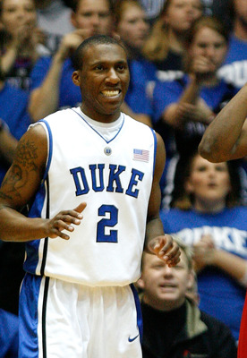 DURHAM, NC - JANUARY 20:  Nolan Smith #2 of the Duke Blue Devils smiles as Farnold Degand #12 of the North Carolina State Wolfpack reacts to fouling Kyle Singler #12 during the game on January 20, 2009 at Cameron Indoor Stadium in Durham, North Carolina.