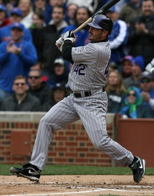 CHICAGO - APRIL 15: Starting pitcher Jason Marquis of the Colorado Rockies, wearing a #42 jersey on Jackie Robinson Day, hits an RBI single in the 2nd inning against the Chicago Cubs on April 15, 2009 at Wrigley Field in Chicago, Illinois. The Rockies def