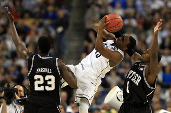 HOUSTON, TX - APRIL 04:  Kemba Walker #15 of the Connecticut Huskies fights for the ball agianst Shelvin Mack #1 and Khyle Marshall #23 of the Butler Bulldogs during the National Championship Game of the 2011 NCAA Division I Men's Basketball Tournament at