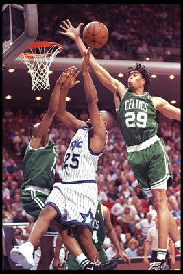 4 Apr 1996:  Guard Nick Anderson of the Orlando Magic lays up the ball as forward Pervis Ellison of the Boston Celtics tries to block him during a game at the Orlando Arena in Orlando, Florida.  The Celtics won the game 100-98. Mandatory Credit: Allsport