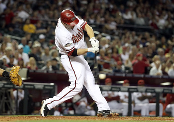 PHOENIX, AZ - MAY 03:  Xavier Nady #22 of the Arizona Diamondbacks hits a two RBI single against the Colorado Rockies during the third inning of the Major League Baseball game at Chase Field on May 3, 2011 in Phoenix, Arizona.  (Photo by Christian Peterse