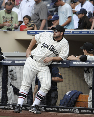 SAN DIEGO, CA - JUNE 11: Heath Bell #21 of the San Diego Padres, wearing a throwback uniform, leans on the rail before a baseball game against the Washington Nationals at Petco Park on June 11, 2011 in San Diego, California.   (Photo by Denis Poroy/Getty