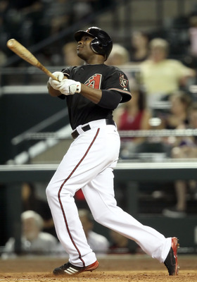 PHOENIX, AZ - JUNE 04:  Justin Upton #10 of the Arizona Diamondbacks bats against the Washington Nationals during the Major League Baseball game at Chase Field on June 4, 2011 in Phoenix, Arizona. The Diamondbacks defeated the Nationals 2-0.  (Photo by Ch