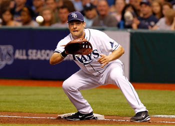 ST. PETERSBURG, FL - MAY 14:  First baseman Casey Kotchman #11 of the Tampa Bay Rays takes the throw at first against the Baltimore Orioles during the game at Tropicana Field on May 14, 2011 in St. Petersburg, Florida.  (Photo by J. Meric/Getty Images)