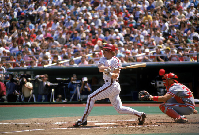 PHILADELPHIA - 1989:  Third baseman Mike Schmidt #20 of the Philadelphia Phillies swings at the pitch during the 1989 season MLB game at Veterans Stadium on 1989 in Philadelphia, Pennsylvania.  (Photo by Rick Stewart/Getty Images)
