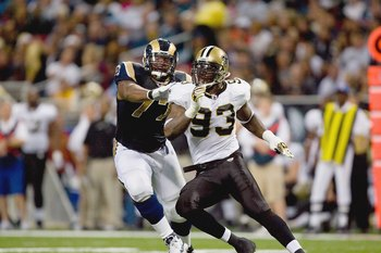 ST. LOUIS - NOVEMBER 15: Bobby McCray #93 of the New Orleans Saints rushes the line against Jason Smith #77 of the St. Louis Rams at the Edward Jones Dome on November 15, 2009 in St. Louis, Missouri.  (Photo by Dilip Vishwanat/Getty Images)