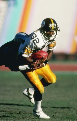 16 Dec 1984:  Wide receiver John Stallworth of the Pittsburgh Steelers moves the ball during a game against the Los Angeles Raiders at the Los Angeles Memorial Coliseum in Los Angeles, California.  The Steelers won the game, 13-7. Mandatory Credit: Rick S