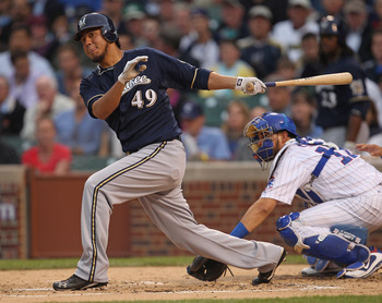 CHICAGO, IL - JUNE 14: Yovani Gallardo #49 of the Milwaukee Brewers takes a swing against the Chicago Cubs at Wrigley Field on June 14, 2011 in Chicago, Illinois. The Cubs defeated the Brewers 5-4 in 10 innings.  (Photo by Jonathan Daniel/Getty Images)