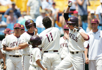 OMAHA, NE - JUNE 22:  Travis Buck #4 (R) of the Arizona State Sun Devils celebrates with teammates after hitting a solo home run in the first inning against the Florida Gators during Game 11 of the 59th College World Series at Rosenblatt Stadium on June 2