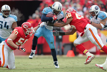 KANSAS CITY, MO - DECEMBER 26:  Chris Johnson #28 of the Tennessee Titans carries the ball as Mike Vrabel #50 and Derrick Johnson #56 of the Kansas City Chiefs defend during the game on December 26, 2010 at Arrowhead Stadium in Kansas City, Missouri.  (Ph