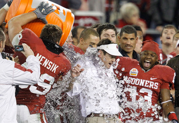 GLENDALE, AZ - JANUARY 01:  Head coach Bob Stoops has a Gatorade bucket dumped on him by Eric Mensik #69 late in the fourth quarter before the Sooners 48-20 victory against the Connecticut Huskies during the Tostitos Fiesta Bowl at the Universtity of Phoe
