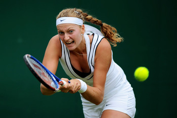 LONDON, ENGLAND - JUNE 21:  Petra Kvitova of the Czech Republic returns a shot during the first round match against Alexa Glatch of the United States on Day Two of the Wimbledon Lawn Tennis Championships at the All England Lawn Tennis and Croquet Club on