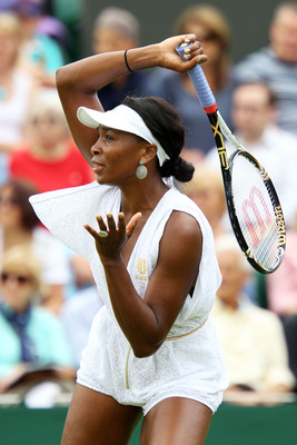 LONDON, ENGLAND - JUNE 20:  Venus Williams of the United States in action during her first round match Akgul Amanmuradova of Uzbekistan on Day One of the Wimbledon Lawn Tennis Championships at the All England Lawn Tennis and Croquet Club on June 20, 2011