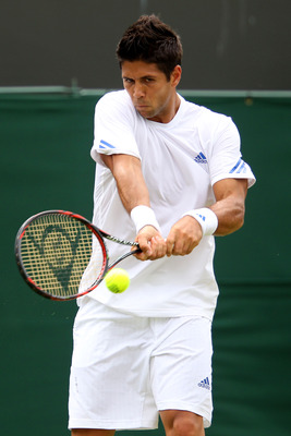 LONDON, ENGLAND - JUNE 21:  Fernando Verdasco of Spain returns a shot during his first round match against Radek Stepanek of the Czech Republic on Day Two of the Wimbledon Lawn Tennis Championships at the All England Lawn Tennis and Croquet Club on June 2