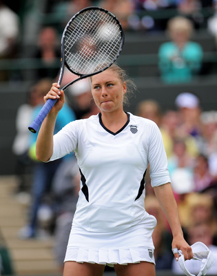 LONDON, ENGLAND - JUNE 20:  Vera Zvonareva of Russia waves to the crowd after winning her first round match against Alison Riske of the United States on Day One of the Wimbledon Lawn Tennis Championships at the All England Lawn Tennis and Croquet Club on