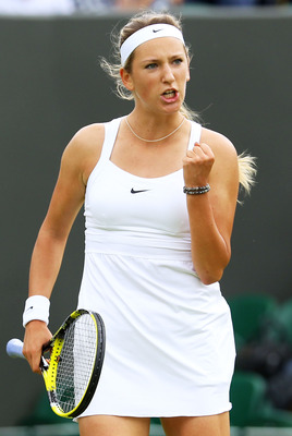 LONDON, ENGLAND - JUNE 20:  Victoria Azarenka of Belarus reacts to a play during her first round match against Magdalena Rybarikova of Slovakia on Day One of the Wimbledon Lawn Tennis Championships at the All England Lawn Tennis and Croquet Club on June 2