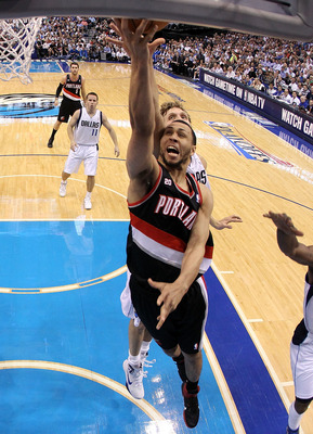 DALLAS, TX - APRIL 25:  Guard Brandon Roy #7 of the Portland Trail Blazers takes a shot against Dirk Nowitzki #41 of the Dallas Mavericks in Game Five of the Western Conference Quarterfinals during the 2011 NBA Playoffs on April 25, 2011 at American Airli