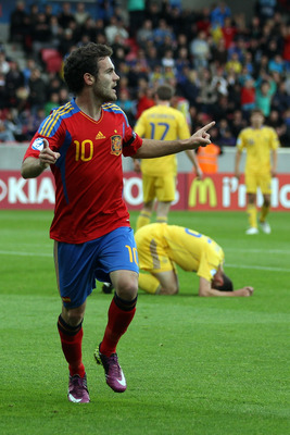 HERNING, DENMARK - JUNE 19:  Juan Mata of Spain celebrates after scoring his team's first goal during the UEFA European Under-21 Championship Group B match between Ukraine and Spain at the Herning Stadium on June 19, 2011 in Herning, Denmark.  (Photo by I