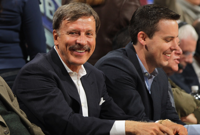 DENVER, CO - MARCH 23:  Stan Kroenke (L) along with his son Josh Kroenke (R) watch from courtside seats as the Denver Nuggets host the San Antonio Spurs at the Pepsi Center on March 23, 2011 in Denver, Colorado. The Nuggets defeated the Spurs 115-112. NOT