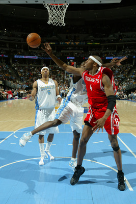 DENVER - APRIL 17:  Stromile Swift #4 of Houston Rockets attempts to rebound the ball against the Denver Nuggets on April 17, 2006 at the Pepsi Center in Denver, Colorado.  The Rockets won 86-83.  NOTE TO USER: USER expressly acknowledges and agrees that,